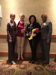 Chairman's Award presented to Jessica Narvaez (third from left) from Pinnacle Resources with Lynda Rhodes, Pauline Shirley, and Mary Boyd (left to right) from WOVI, Inc.